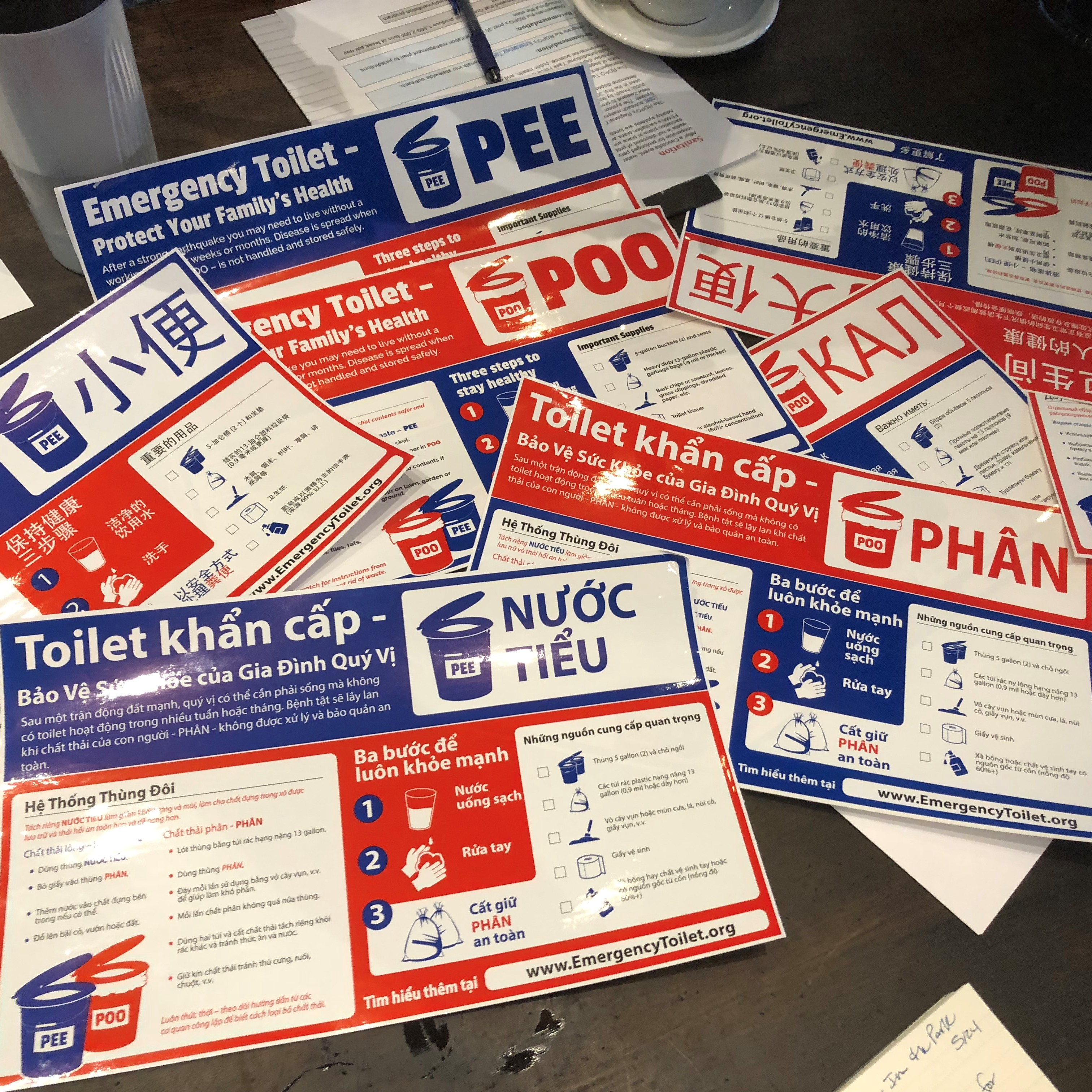 Emergency toilet stickers in many different languages