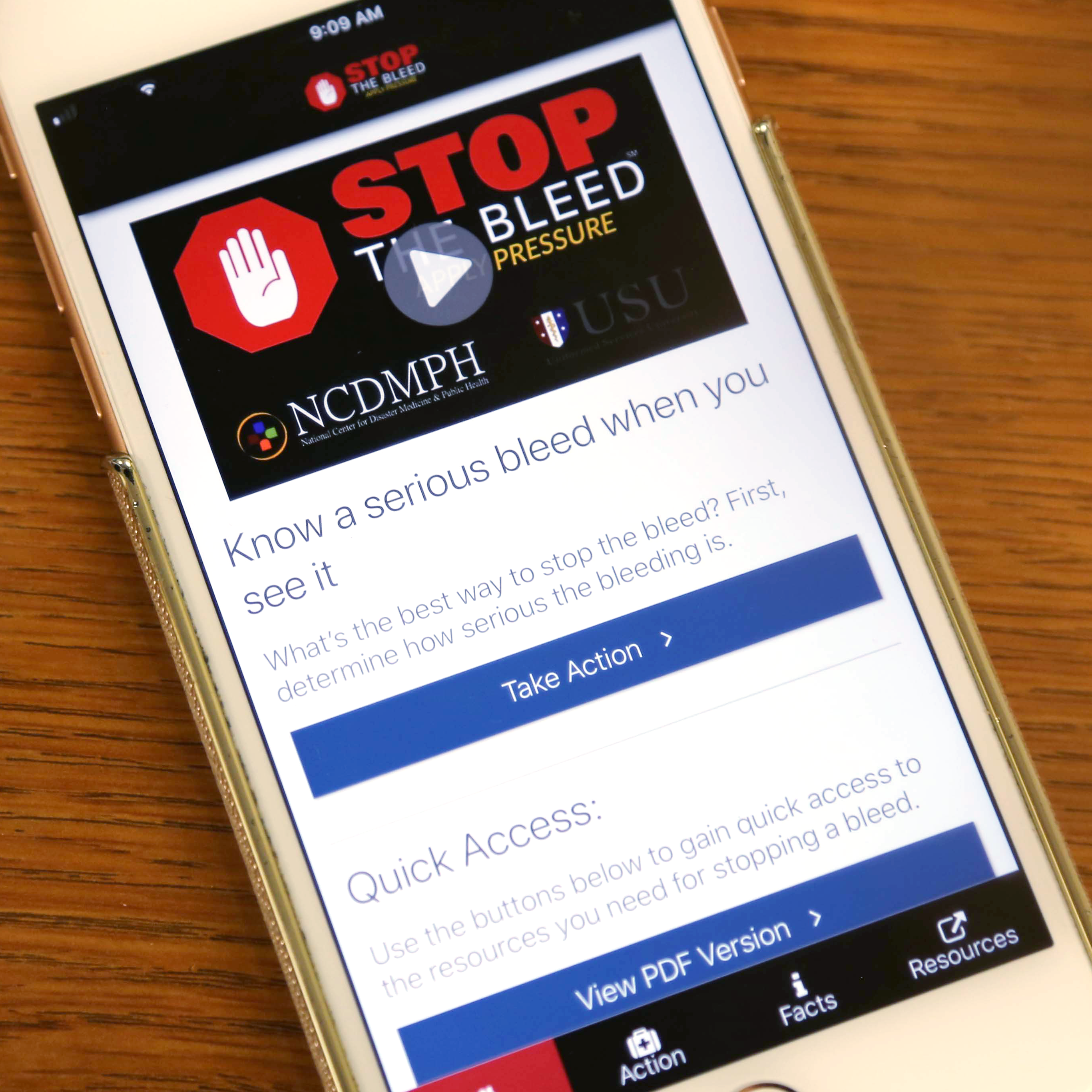Photo of a cell phone with the Stop the Bleed app on the display.