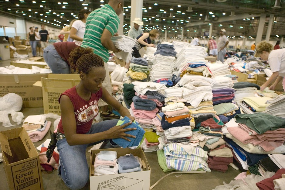 Woman sorting through piles of donations.