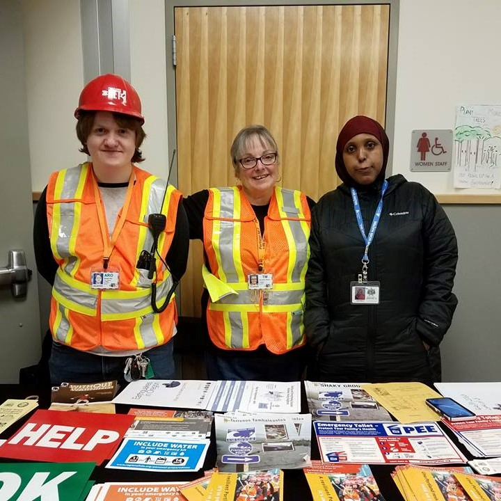 Portland Neighborhood Emergency Team members staff a booth and answer questions about emergency preparedness at an outreach event in Argay Parkrose.